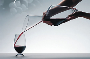Person pouring with Riedel Tyrol Wine Decanter