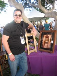 Jake poses with some photos at the Vintage Cellars booth