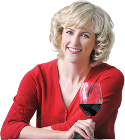 Natalie MacLean holding a glass of wine