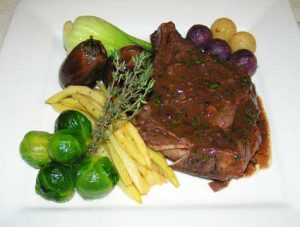 Port wine sauce with veal and assorted vegetables